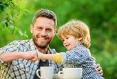 Fathers Day. Best Friends. Father And Son Having Fun. Feeding Son Natural Foods. Healthy Food. Fathe poster