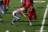 American Football Player Running Toward The End Zone Trying To Avoid The Tackle poster