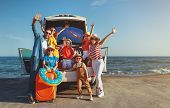 Happy Large Family Mother Father And Children In Summer Auto Journey Travel By Car On Beach poster