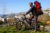 picture of sakhalin  - Man on bicycle on background of tcity - JPG