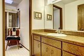 pic of outdated  - Simple browns and white bathroom in old outdated American house - JPG