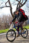 stock photo of sakhalin  - Man on bicycle travels on city - JPG