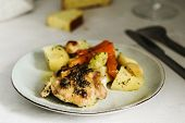 Homemade Herb And Spice Chicken Thighs Baked With Vegetables On A Plate On Grey Background. Homemade poster