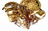 A Scrap Of Gold. Old And Broken Jewelry, Watches Of Gold And Gold-plated Isolated On A White Backgro poster