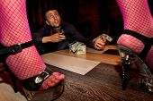 stock photo of stripper shoes  - View of man offering money to a stripper on stage - JPG