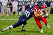 GRAZ, AUSTRIA - JULY 9: LB Samuel Rafaillac (#40 France) tackels RB Matt Walter (#33 Canada) at the