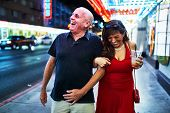 mature couple sightseeing in downtown las vegas streets poster