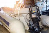 Repairing Inflatable Motorboat Engine At Boat Garage. Ship Engine Seasonal Service And Maintenance.  poster