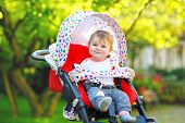 Cute Healthy Little Beautiful Baby Girl Sitting In The Pram Or Stroller And Waiting For Mom. Happy S poster