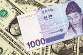 A Blue South Korean One Thousand Won Bank Note Close Up In Macro On A Background Of American One Dol poster