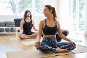 Calm Peaceful Fitness People Doing Yoga In Gym. Man And Woman Sitting On Mats In Lotus Pose. Trainin poster