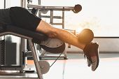 Close Up Of Sport Man Stretching And Lifting Weight By Two Legs When Facing Down For Stretching Musc poster