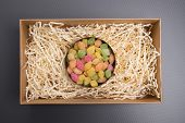 Candy In A Jar. Candy In A Carton Box. Gift Box With Candy. Tin Can With Colored Lollipops On A Gray poster