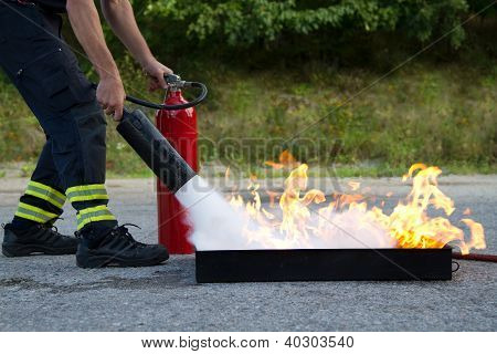 Instructor showing fire extinguisher