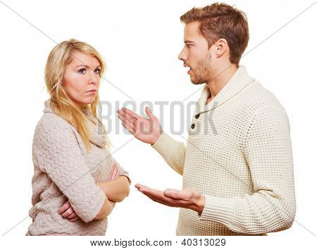 Angry man argueing with sulking woman with the arms crossed