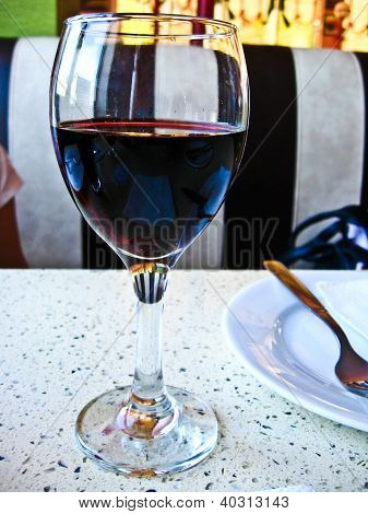 glass of red wine on the table