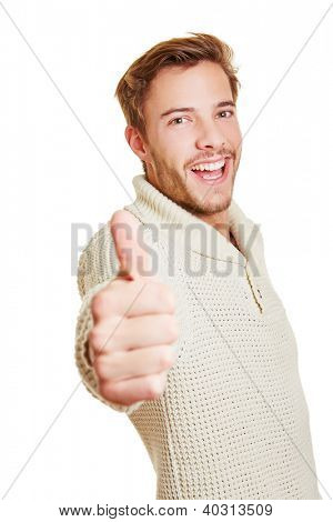 Happy attractive smiling man holding his thumbs up