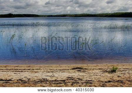 Karelian Lake Landscape Background With Sand And Forest