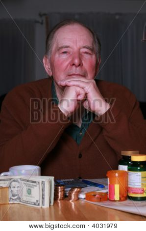 Elderly Man With Money And Medications