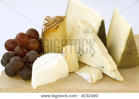 An Assortment Of Cheeses On A Cheese-Board