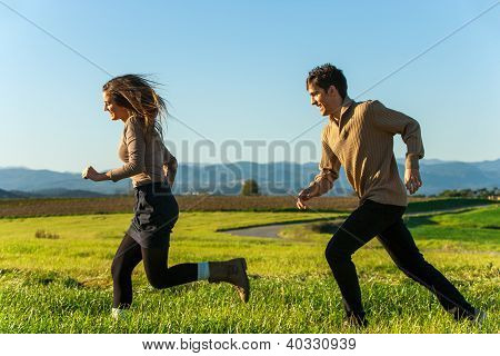 Happy Couple Having A Race Outdoors.