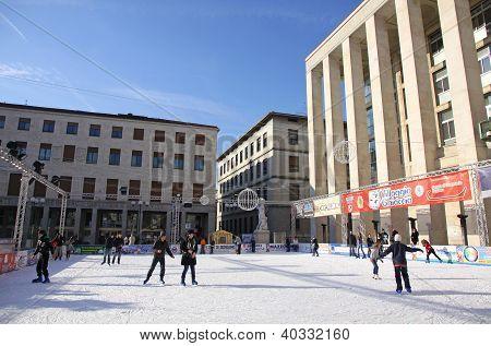 People Enjoying Ice Skating Rink In Bergamo, Italy