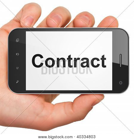 Hand holding smartphone with word Contract on display. Generic m