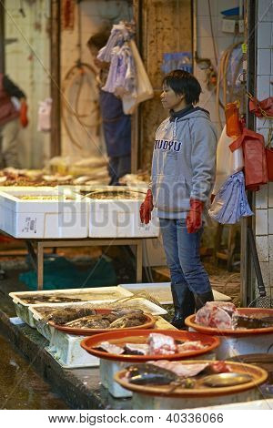 Woman selling fish