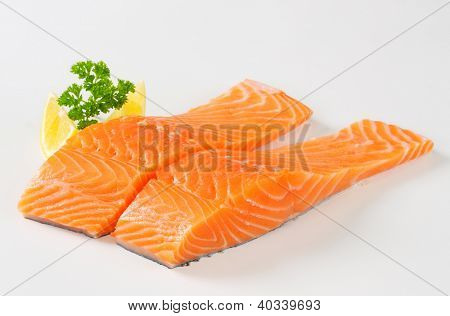 two salmon fillets on the white background