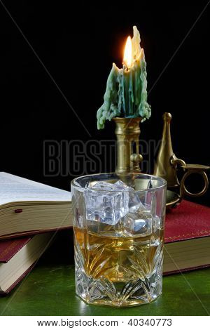 Whisky And Antique Candlestick