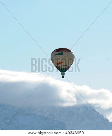 Hot Air Balloon Above Mountains