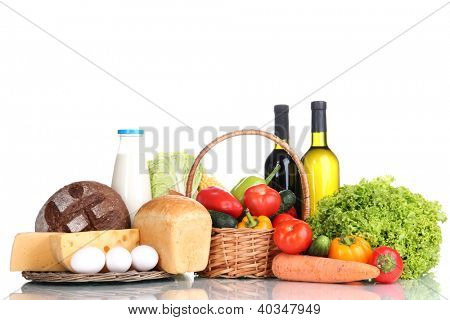 Composition with vegetables  in wicker basket isolated on white