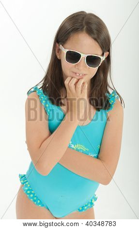 Young girl with sunglasses and swimming costume