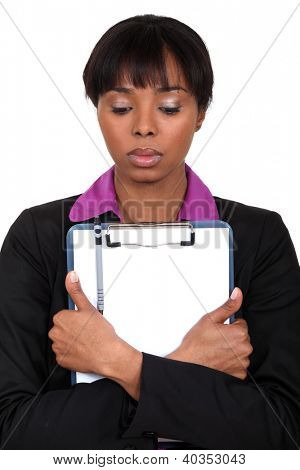 Sad woman holding a clipboard