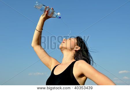 Young Woman Drinking Cold Water