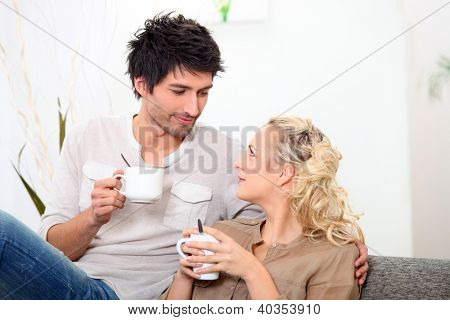 Couple having a cup of coffee together in the morning