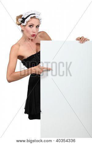 Blond woman dressed in maid costume