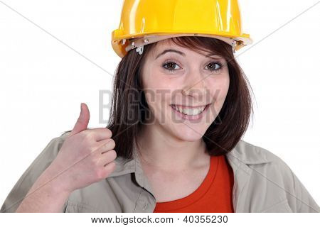 Female builder giving thumbs-up