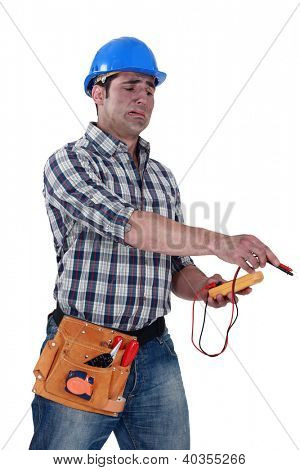 Electrician with a voltmeter