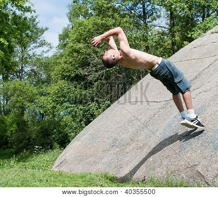 Young Man Doing Salto Outdoors