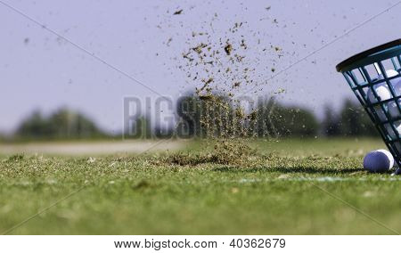 Closeup of a golf bucket and ball