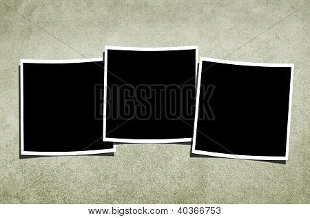 Blank Polaroids Over Vintage Background