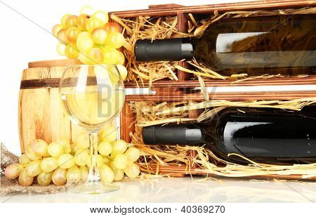 Wooden case with wine bottle, barrel, wineglass and grape isolated on white