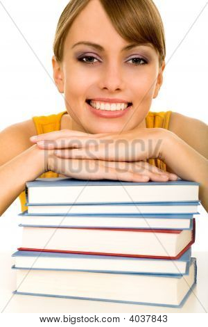 Woman Leaning On Stack Of Books