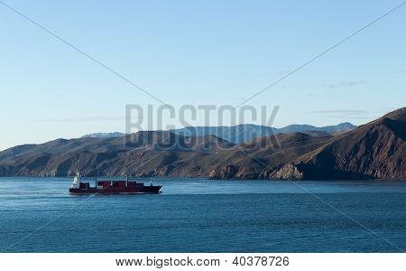 Cargo Ship Near The Coastline