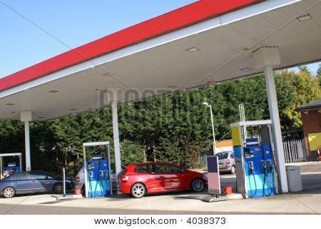 Cars In Petrol/ Gas/ Service Station For Fuel.