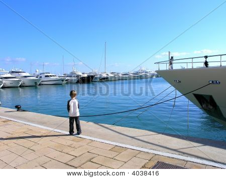 Boy In A Marina