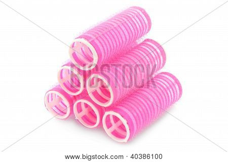 Stack of pink hair rollers