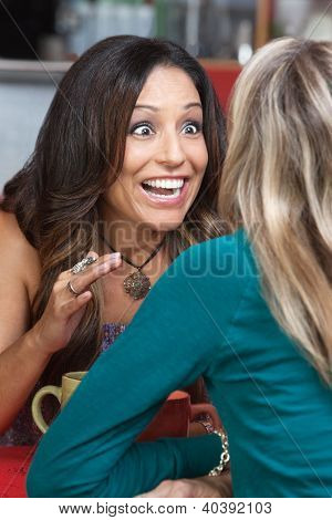 Excited Woman Talking In Restaurant