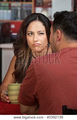 Frowning Woman Looking At Man